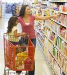 Mom and daughter in grocery store cropped