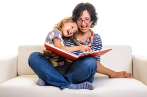 Mother, girl reading funny book laughing dreamstime_m_36281429